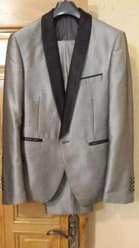 Silver pent coat new condition