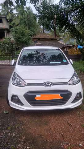 Hyundai Xcent petrol July 15 white Bicholim-Goa Registered