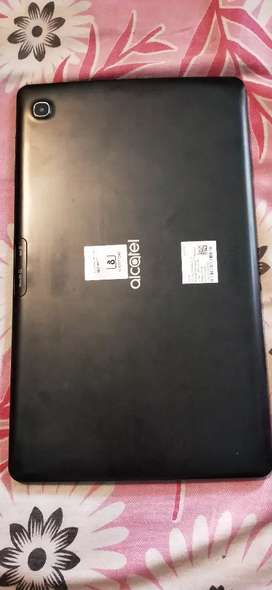 Alka tel tablet show room condition 1yr old with cover of 999 free
