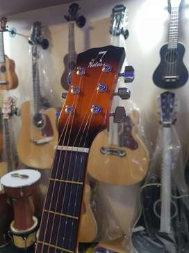 7 notes student guitars