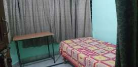 One small semi furnished room available with food. Only for boys.