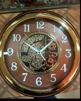Jam dinding kaligrafi timbul