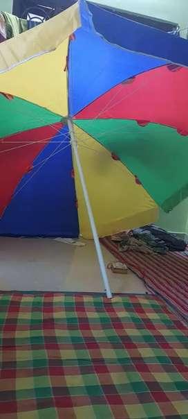 Multicolored umbrella for shop , garden#bech #food park