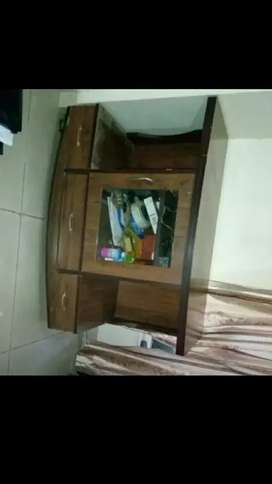 TV trolley with three drawer in bottom and one cupboard in middle