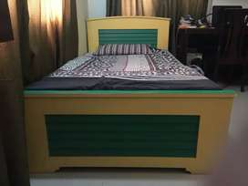 Single bed with cupboard