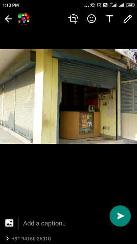 Shop corner side with double shutter in commercial complex