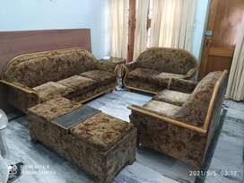 7 Seater Sofa with Setty (having storage) and Corner Table