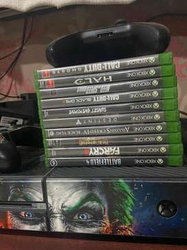 X box one game console with cds