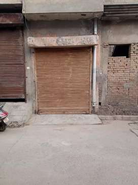 A shop with shutter situated near a good marketplace