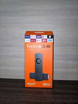 Fire TV 4k, smart TV stick, brand new with Alexa enabled voice remote.