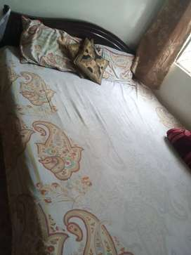 Wooden bed with metress