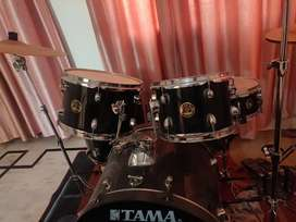Tama Rhythm Mate drum kit with accessories and cymbals.