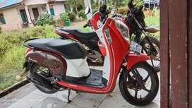 Dijual sepeda motr scopy wrna merah... Posisi tapin