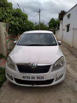 Skoda Rapid Diesel Good Condition, candy white color.