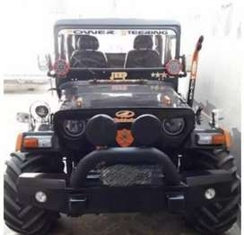 Modified willy in black and orange jeep
