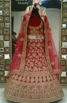 This bridal lehnga has been used once and is in excellent condition.
