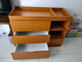 Changing table for babies with drawers
