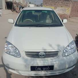 Xli 2003 White color ,Lahore number chill AC,