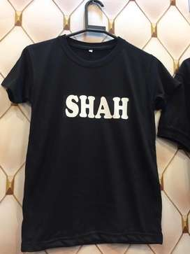 T shirt with white print name.
