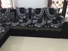 L shaped black and white stripes sofa cum bed with storage
