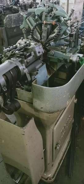 Sliding head machines