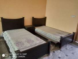 Two single beds with center table