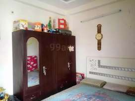 Well maintained builder floor with wooden tiles