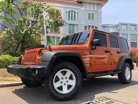 Jeep Wrangler Sport Unlimited 3.8cc 2012 Oranye 4DR Bensin LED Mopar