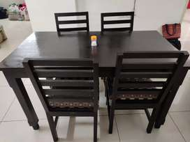 Dining table for 4 made of teak wood in good condition