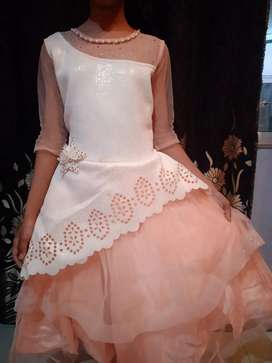 New peach gown with white foam.