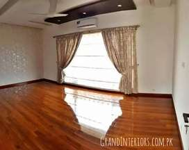 Vinyl flooring and wooden floor Or wood flooring by Grand Interiors