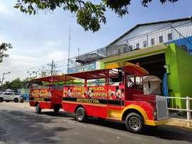 Kereta wisata mobil merah odong odong keliling kampung Er