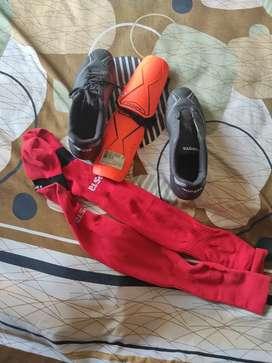 Football foot kit shoes socks and guard.