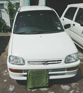 Daihatsu Cuore appealing colors is white genuine, model is 2010