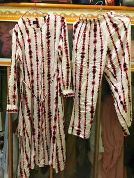 Baju 1 set ( tunik+celana) sekali pake