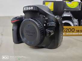 Nikon D5200 with two kit lenses (18-55 or 55-200)