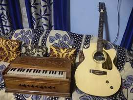 1 year old guitar and 3 year old harmonium