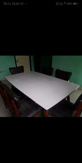 Large rectangular dining table with six seats