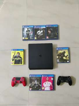 PS4 Slim 500GB with 2 Controllers and 7 Games