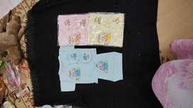 Pakaian bayi baru lahir
