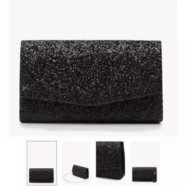 Iam selling Black And White Branded Booho Clutches
