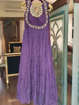 A purple gown with handwork
