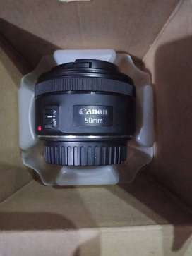 CANON 50MM LENSE WITH HOOD ONLY IN 10,000/-