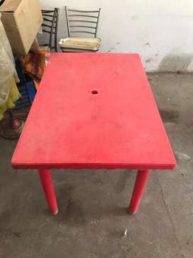 Plastic table with four chairs