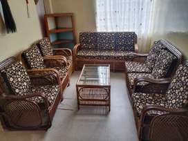 Set of can chair with glass table and sofas