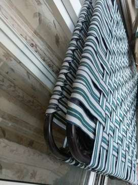Iron cot with nylon belts