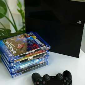 Sony playstation 4 console 8 games with warranty