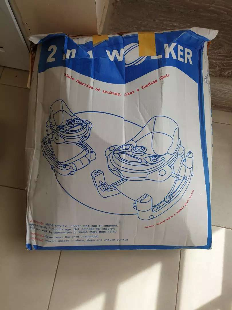 2 in 1 baby walker and rocker in excellent condition 0