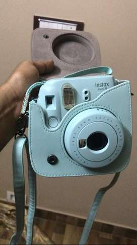 Instax Mini 9 with a selfie mirror.