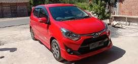 Toyota Agya facelift merah merona